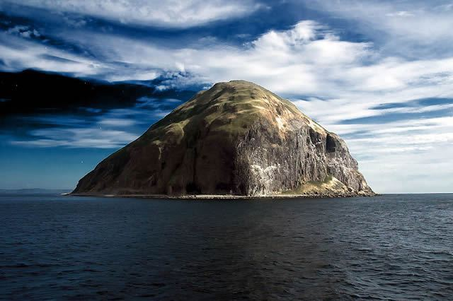 Ailsa Craig now home to a population of over 30,000 gannets, over a thousand feet high