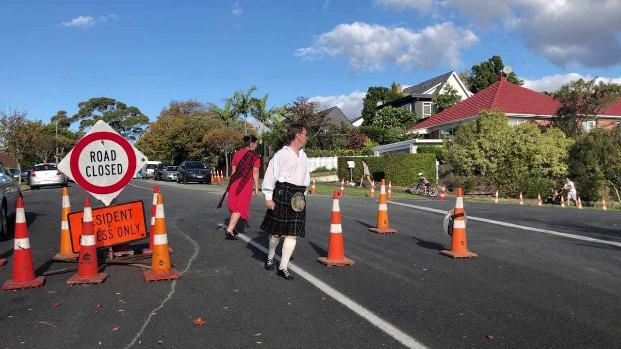 Couple dancing Conical Chronicles in the road works